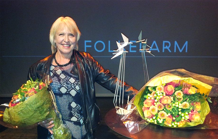Eli Storbekken fekk ein pris på Folkelarm 2014 for arbeidet ho har gjort med Rosekolla.